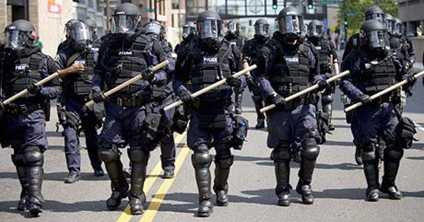 Police in Riot Gear - disproportionate to the threat